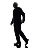 Senior business man walking silhouette Stock Photo