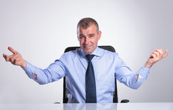 Senior business man welcomes you form desk Stock Photography