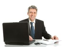 Senior business man working on laptop Royalty Free Stock Images