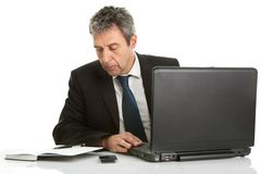 Senior business man working on laptop Stock Photo