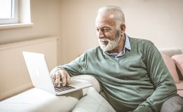 Senior man with laptop. stock photo