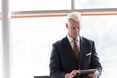 Senior business man working on tablet computer Royalty Free Stock Photography