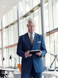 Senior business man working on tablet Royalty Free Stock Image