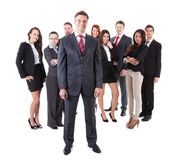 Senior business manager standing on front of his team royalty free stock image