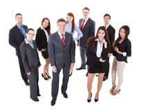 Senior business manager standing on front of his team Stock Photo