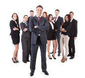 Senior business manager standing on front of his team royalty free stock images