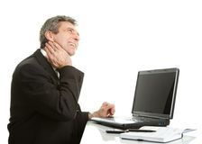 Senior business men having neck pain Royalty Free Stock Images