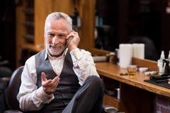 Senior business sitting man talking on mobile phone Stock Photography