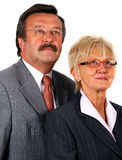 Senior Business Team Looking Into The Future. A mature business couple looking up. Isolated over pure white Stock Photo