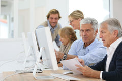 Senior business training class. Group of senior people in business training class royalty free stock image