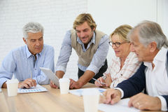 Senior business training meeting with instructor Stock Photos