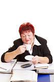 Senior business woman drinking Stock Image
