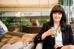 Senior business woman drinking mojito Stock Image