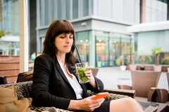 Senior business woman drinking mojito Royalty Free Stock Images