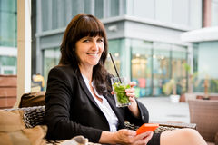 Senior business woman drinking mojito Royalty Free Stock Photography