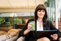 Senior business woman drinking mojito and working Royalty Free Stock Photo