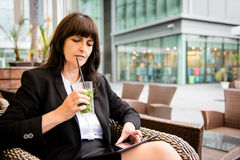 Senior business woman drinking mojito and working Royalty Free Stock Image