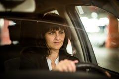 Senior business woman driving car Stock Photo