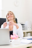 Senior business woman having cup of coffee. And dreaming about vacation Royalty Free Stock Photos