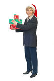 Senior business woman hold Christmas presents stock photography
