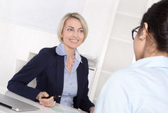 Senior business woman in interview with a trainee - application Royalty Free Stock Images