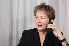 Senior business woman on the phone Stock Image