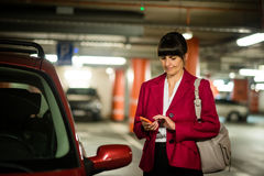 Senior business woman with phone at car Royalty Free Stock Photos