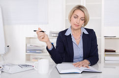 Senior business woman planning at desk. Stock Photo