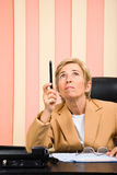 Senior business woman pointing up with pencil Stock Photography