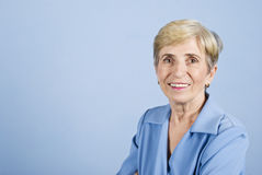 Senior business woman smiling stock photography