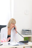 Senior business woman speaking phone. At office Royalty Free Stock Images