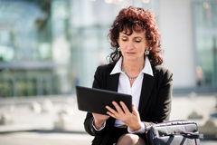 Senior business woman with tablet in street Royalty Free Stock Photo