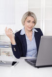 Senior business woman talking with webcam. Royalty Free Stock Images