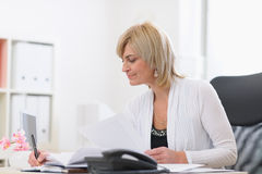 Senior business woman at work stock images