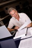 Senior businessman. Checking some papers stock photography