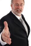Senior Businessman. Holding out hand for a hand shake. Focus on hand Stock Images