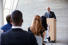 Senior Businessman Addressing Delegates At Conference Royalty Free Stock Photography