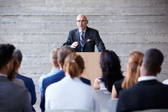 Senior Businessman Addressing Delegates At Conference Royalty Free Stock Photo