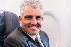 Senior businessman airplane Stock Photography