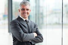 Senior businessman arms crossed Stock Photography