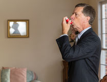 Senior businessman with asthma inhaler stock photos