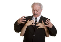Senior businessman being harassed Royalty Free Stock Images