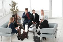 Business partners negotiate in the presence of a business team. Senior businessman and business team sitting in the lobby of the modern office. meetings and Stock Photo