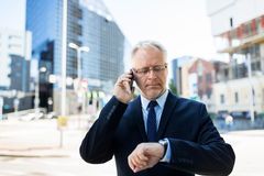 Senior businessman calling on smartphone in city Royalty Free Stock Image