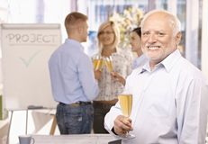 Senior businessman celebrating in office Royalty Free Stock Photography