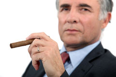 Senior businessman with cigar Stock Photos
