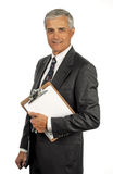 Senior Businessman With Clipboard Royalty Free Stock Photo