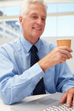 Senior businessman with coffee Stock Images