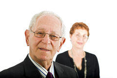 Senior businessman with colleague stock image