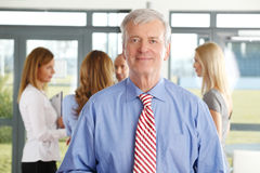 Senior businessman with collegaues Stock Photo